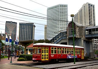 NewOrleansHUDRedStreetcarRiverfrontCanal1 Suburban rail: An idea whose time has come … again? Act 1