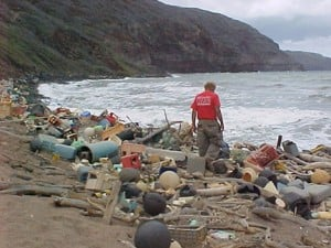 Person amidst washed-up-on-shore-debris, Hawaii